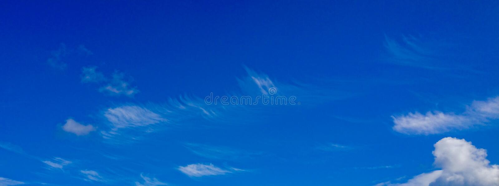 Wind Blown Fluffy Clouds Blue Skyscape. Wind Blown Fluffy Clouds Blue royalty free stock photography