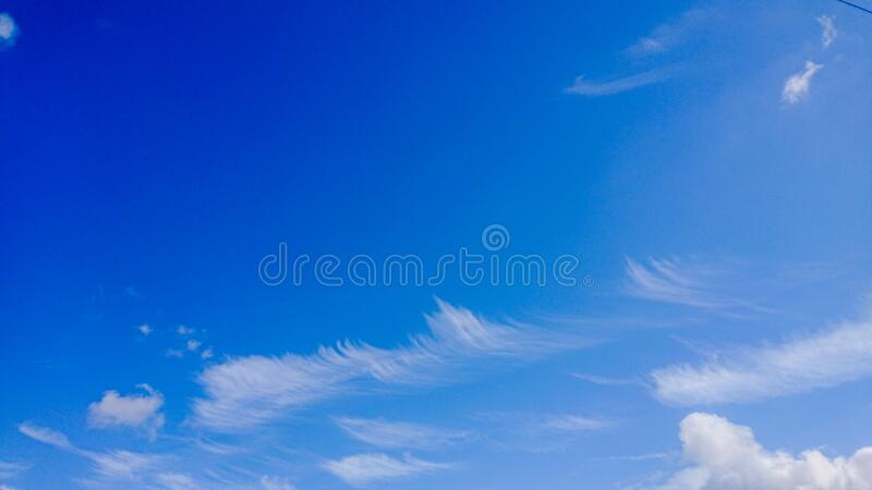 Wind Blown Fluffy Clouds Blue Skyscape. Wind Blown Fluffy Clouds Blue stock photos