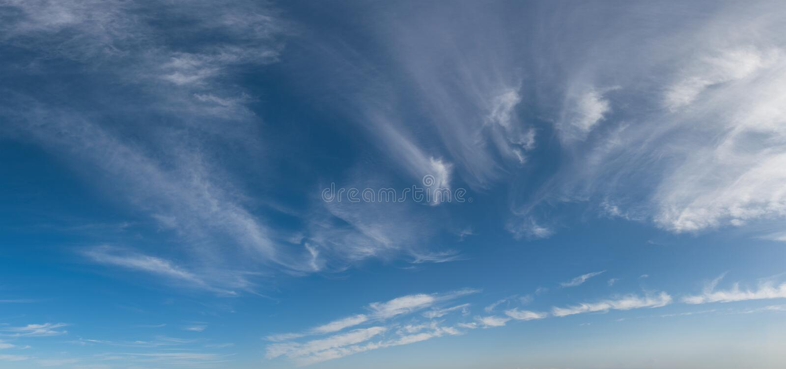 Wind blown wispy white clouds panorama stock photos
