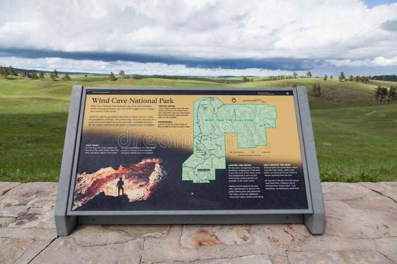 Wind Cave Park Map Sign. WIND CAVE NATIONAL PARK, SOUTH DAKOTA - June 11, 2014:  An informational sign showing a map with a dynamic background view in Wind Cave royalty free stock photo