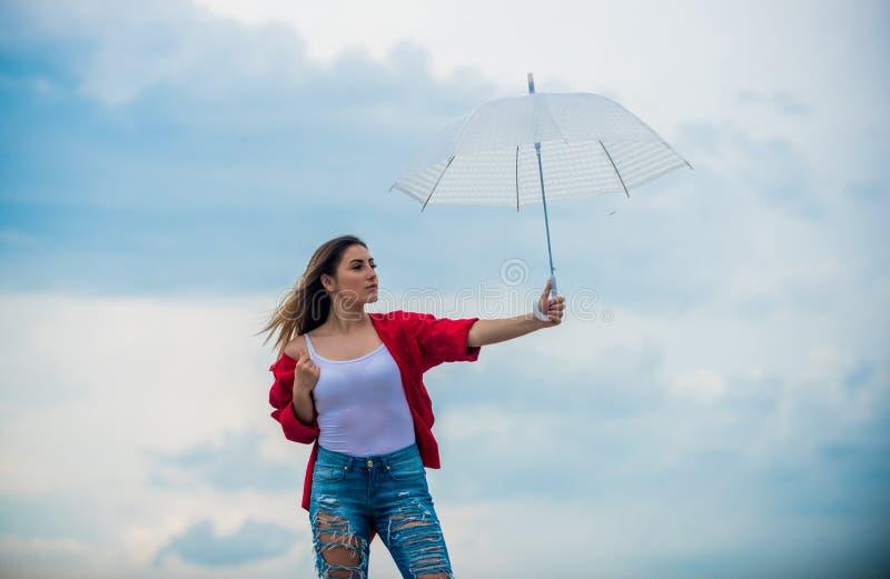 Wind of change. Pretty woman with light umbrella. Rainbow umbrella. Rainy weather. Good mood. Good vibes. Girl feeling stock image