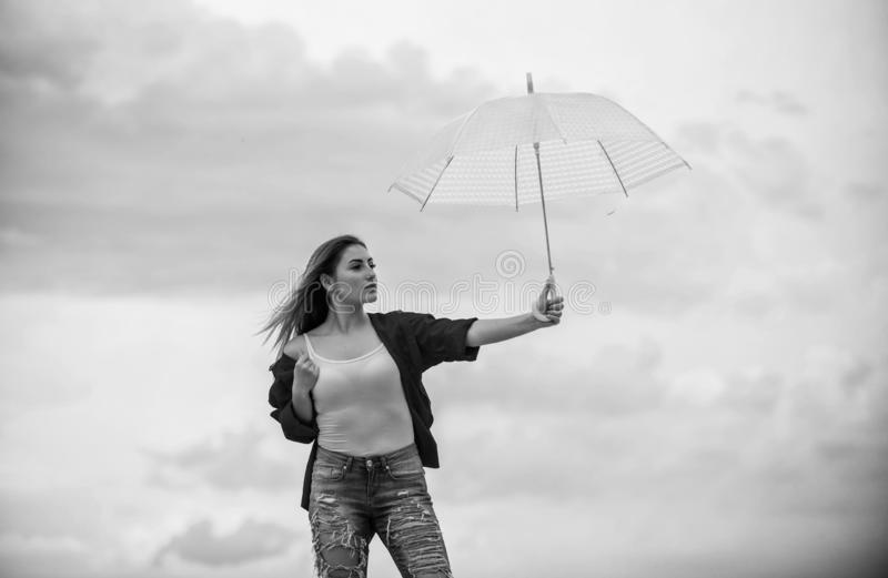 Wind of change. Pretty woman with light umbrella. Rainbow umbrella. Rainy weather. Good mood. Good vibes. Girl feeling royalty free stock photo