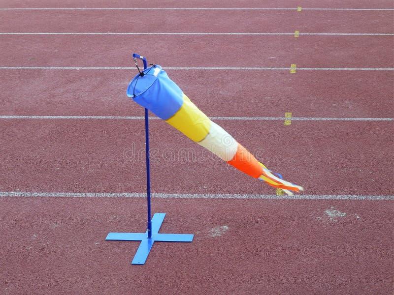 Wind cone weather vane. Wind check athletics race at red athletics field Wind cone weather vane stock photo