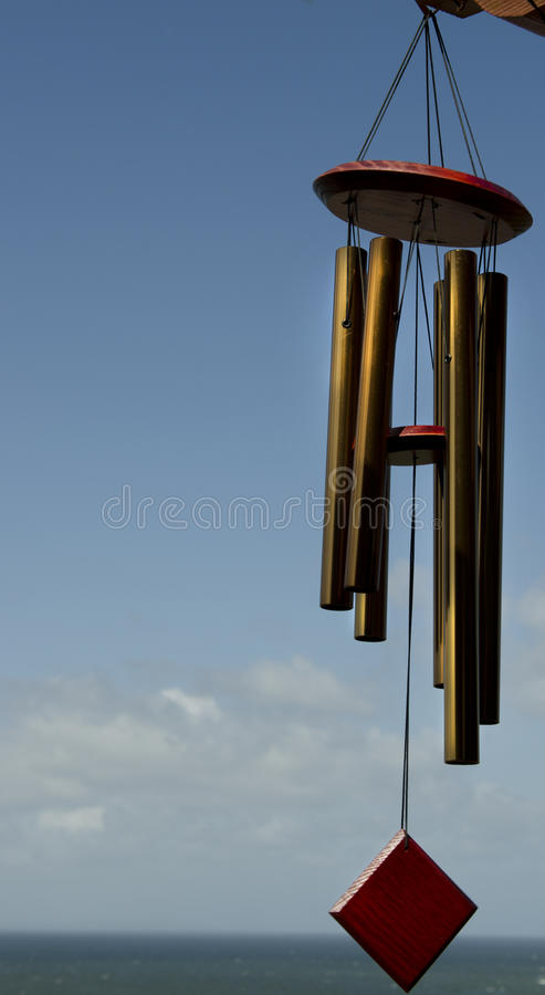 Wind Chime. Windchimes hanging against blue sky with copyspace royalty free stock photos