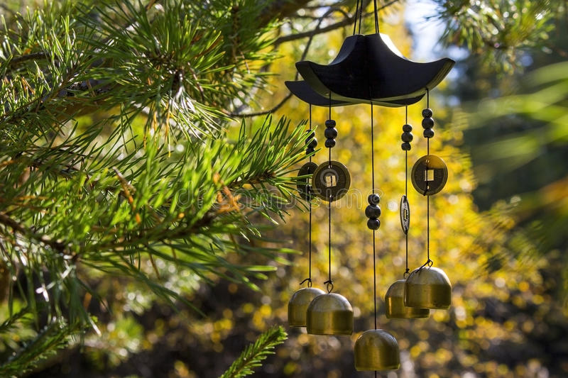 Wind chimes in autumn garden royalty free stock photo