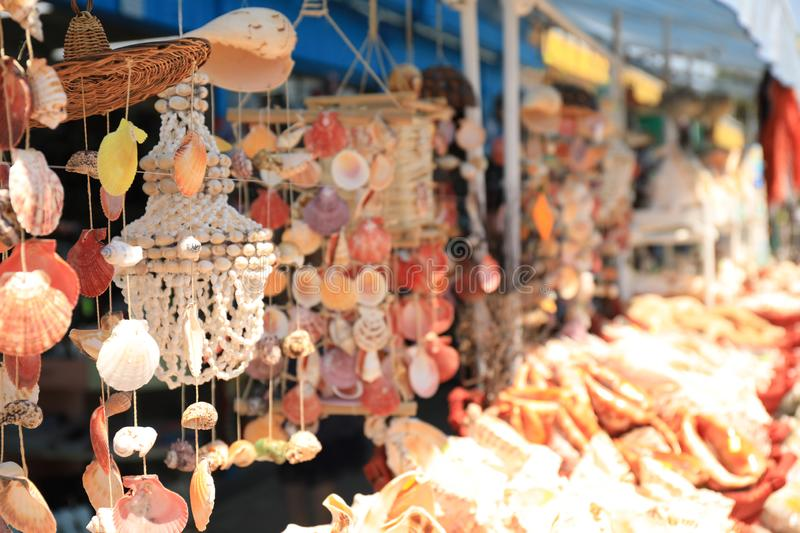 Wind chimes made of sea shells in outdoor souvenir shop. Space for text royalty free stock photos