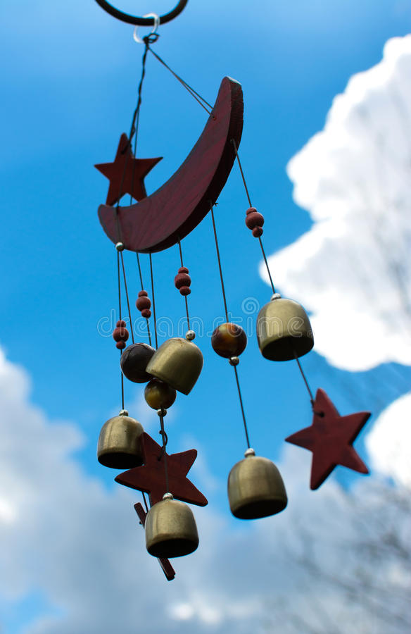 Wind Chimes. Moon and stars wind chimes with blue sky background stock photo