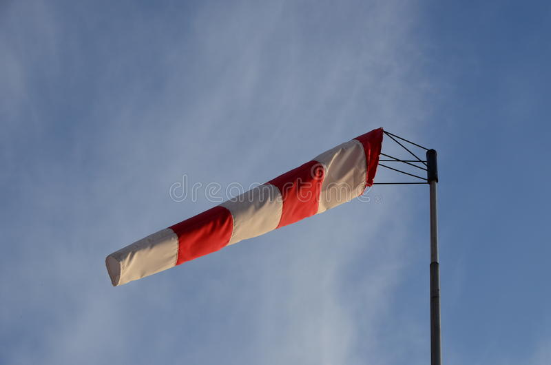 Wind cone weather vane. On windy day with blue sky in the background royalty free stock photo
