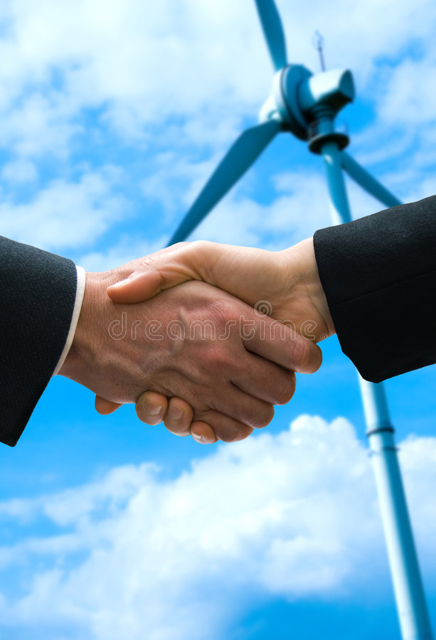 Wind Deal. Alternative energy deal with a hand shake stock photography