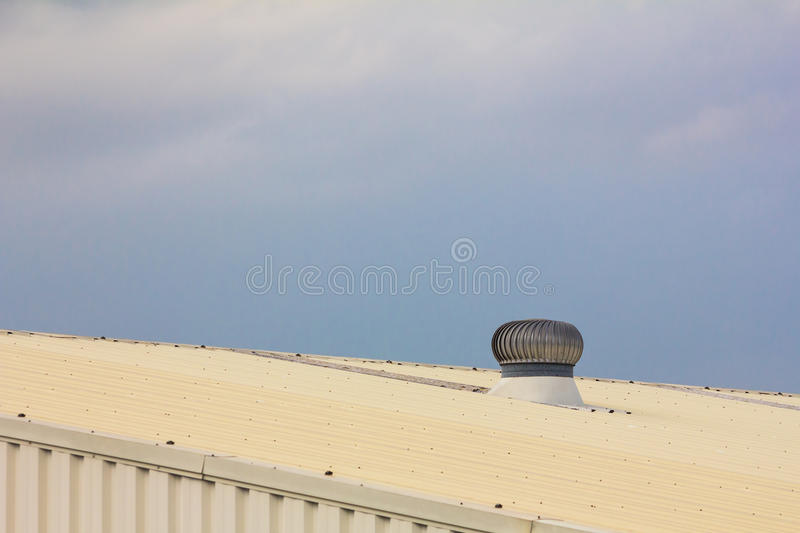 Wind driven rooftop ventilator stock photography