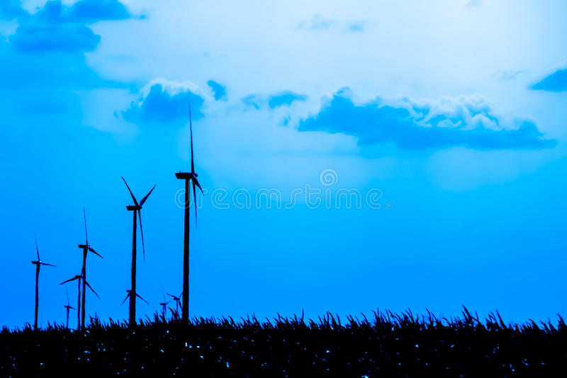 Wind Energy. Silhouettes Of Wind Turbines Converting Wind Energy To Electricity stock photo
