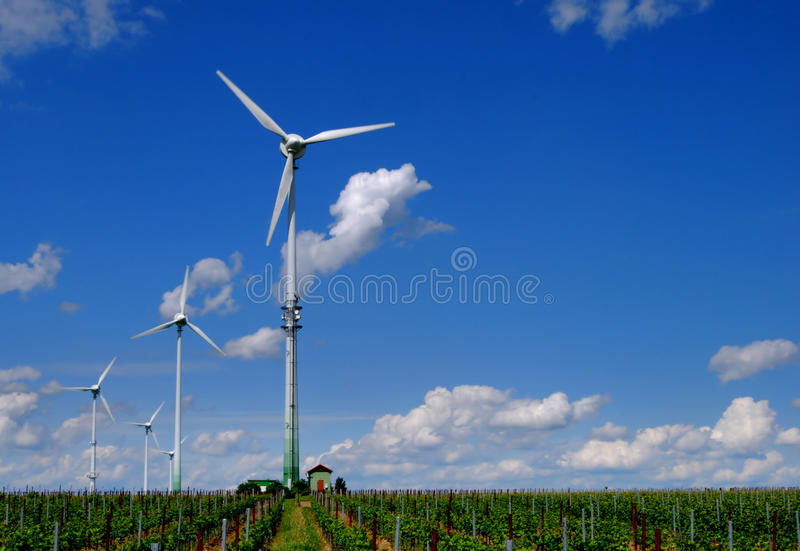 Wind energy. Tower in a vineyard royalty free stock photos