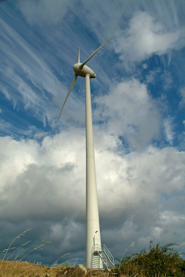 Wind Energy. Modern wind mill, energy generator. In the end of the day at Santa Maria Azores stock images