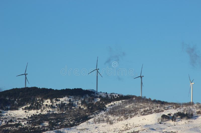 Wind energy, eco-friendly way to produce energy. Windmill and blue sky stock photos