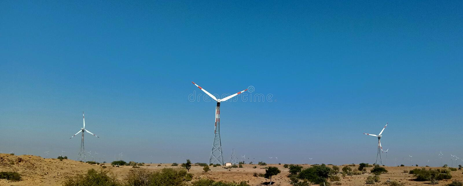 Wind energy old tower in sky blue. Wind energy old tower in desert stock image
