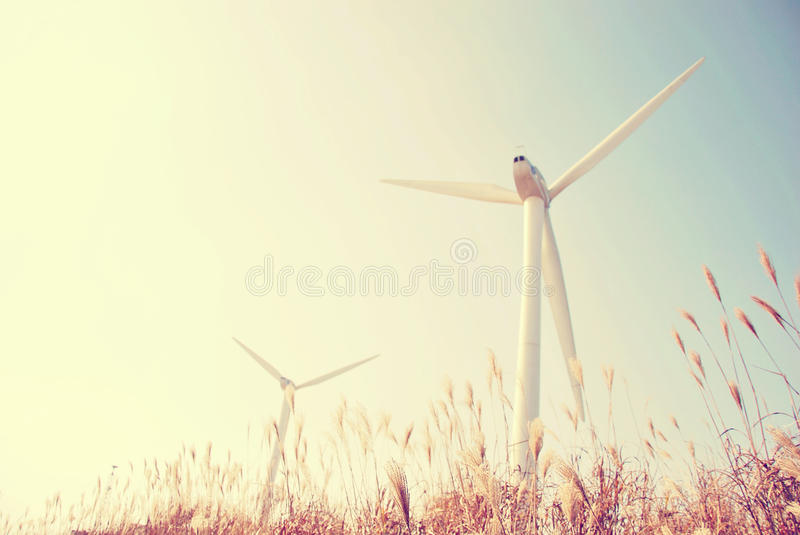 Wind energy source. Windmill blue sky stock photos