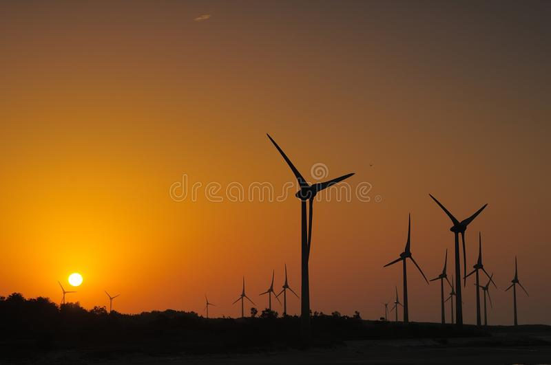 Wind energy and sunset. A new generation of energy generated by Wind generators to us royalty free stock photos