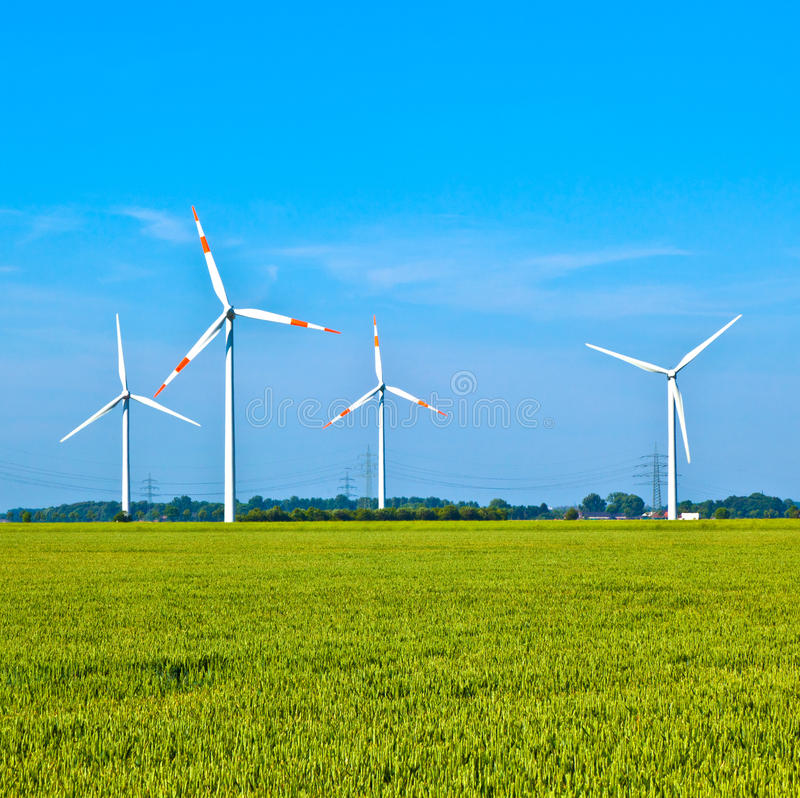 Wind energy wowers standing in the field. In spring stock photo
