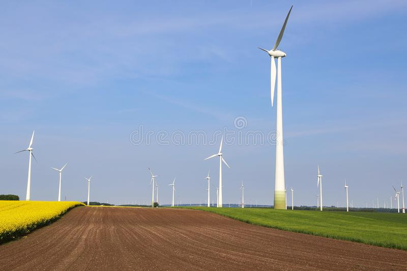 Wind engines in the fields in Germany.  stock photos