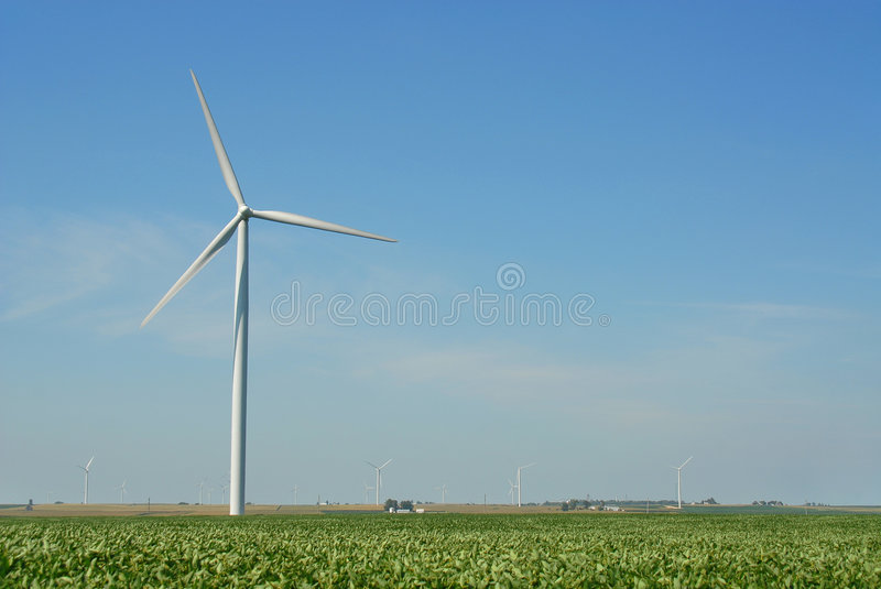 Wind Farm 12. A giant wind turbine stands in a midwestern field in a field full of these alternate energy sources stock photos