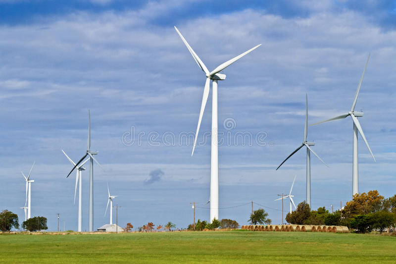 Wind farm and hay bales royalty free stock photos