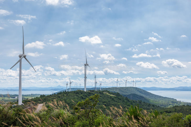 Wind farm on lakeside. Clean energy background royalty free stock images