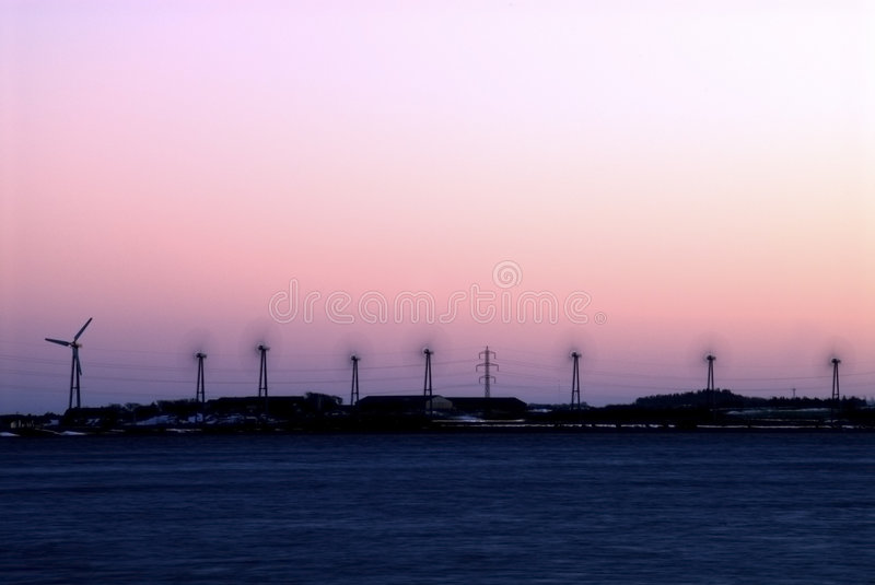 Wind farm at night stock image