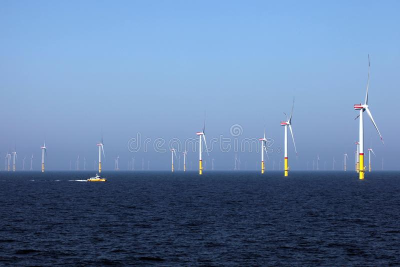 Wind farm offshore, green electricity stock images