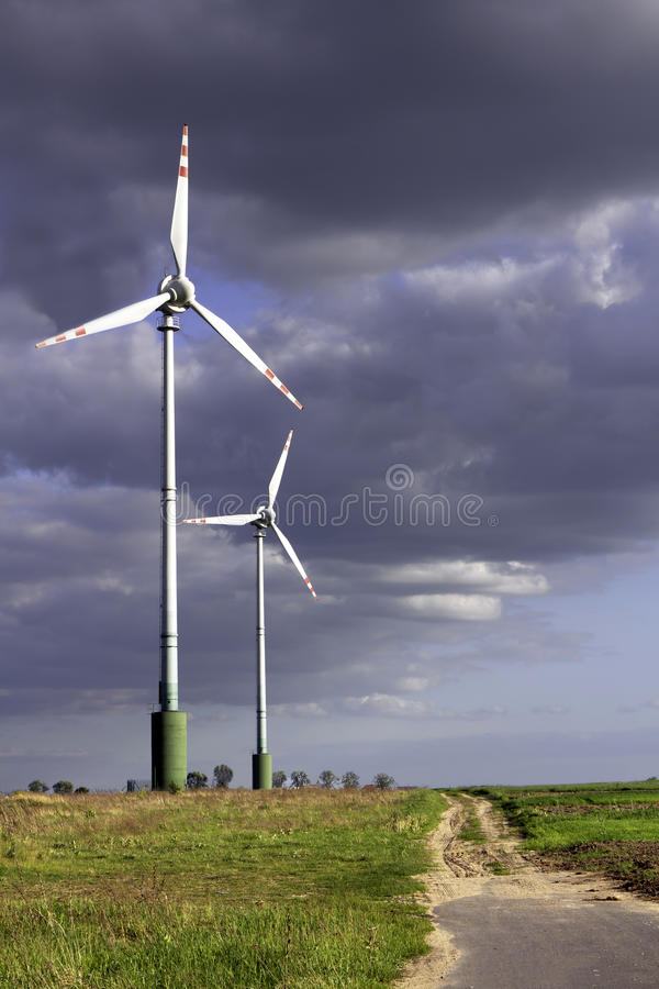 Wind farm on the stormy sky royalty free stock images