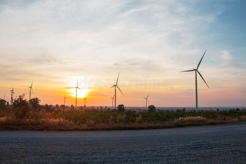 Wind farm with sunrise. stock photo