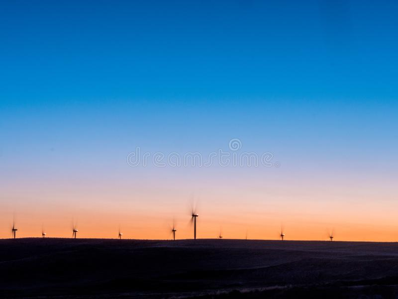 Wind farm at sunset royalty free stock photo