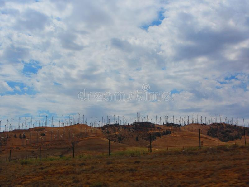 Wind farm, view of hundreds of wind trubines in mountainous fields in California. Example of sustainable energy, fighting global warming or climate change stock images