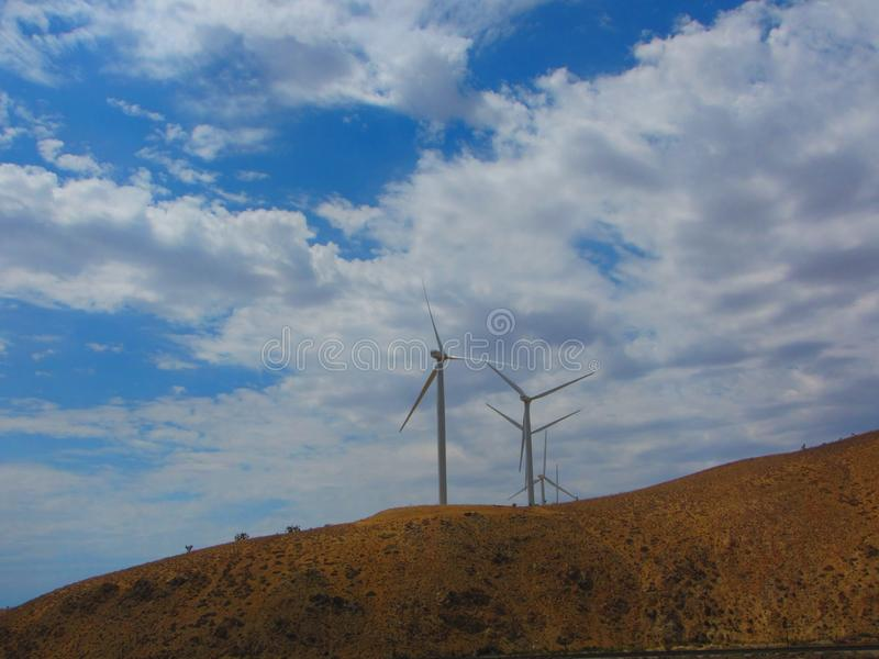 Wind farm, view of several wind trubines on mountainside in California. Wind farm, view of hundreds of wind trubines in mountainous fields in California royalty free stock image