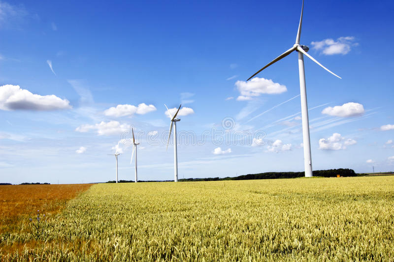 Wind generator. On agricultural field royalty free stock image