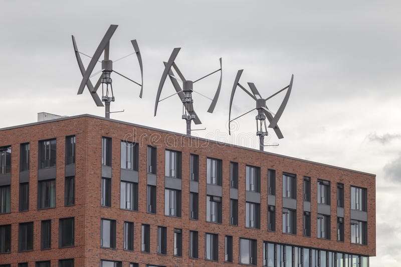 Wind Generators. Wind energy production atop a building in the HafenCity of Hamburg, Germany stock photography