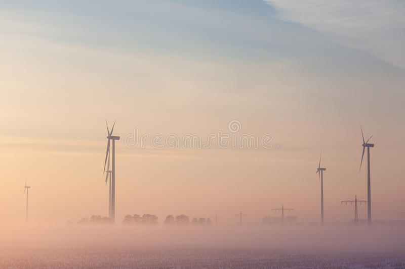 Download Wind Generators  On A Field During Winter Stock Photo - Image: 83708068