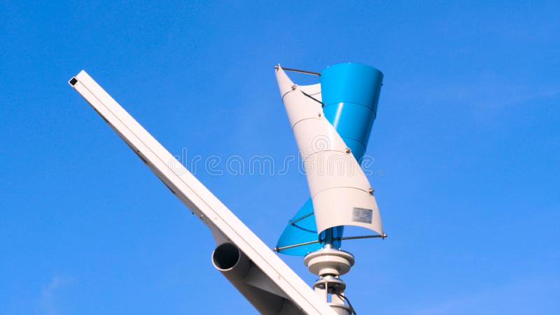 Wind generators on the sea coast, Offshore Wind Energy Park. Windmill concept of green energy wind farm in field by the sea royalty free stock photography