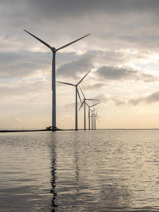wind generators in a sea stock photo