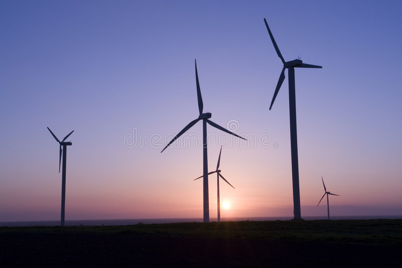 Wind generators at sunset royalty free stock images