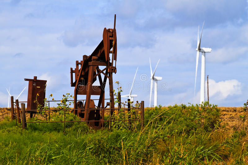 Wind gerators and oil wells stock photo