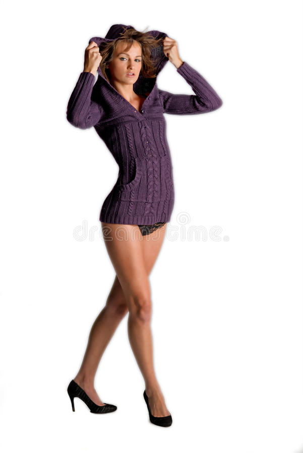 Wind in her hair a seductive woman pulls up a hood royalty free stock photos