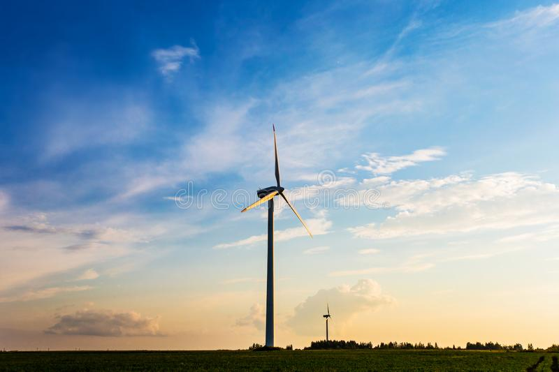 Wind industry in countryside. Wind turbines in field. Sunrise on farmlands. Wind industry in the countryside. Wind turbines in field. Sunrise on farmlands stock photography