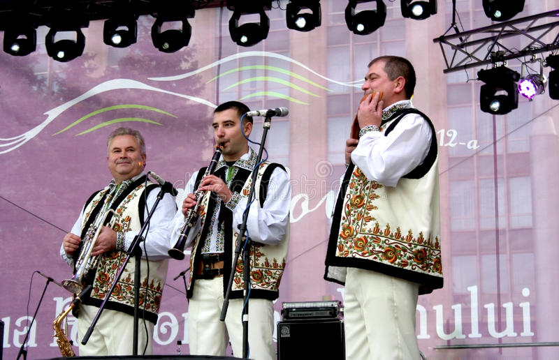Download Wind Instruments Performers Have Fun Playing Music In The Moldovan National Costumes Editorial Image - Image: 34852485