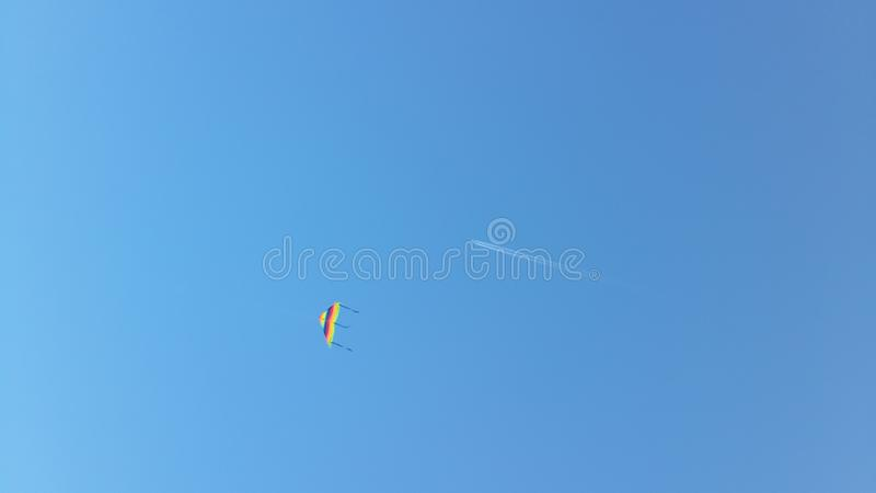 Wind kite and airplane royalty free stock images