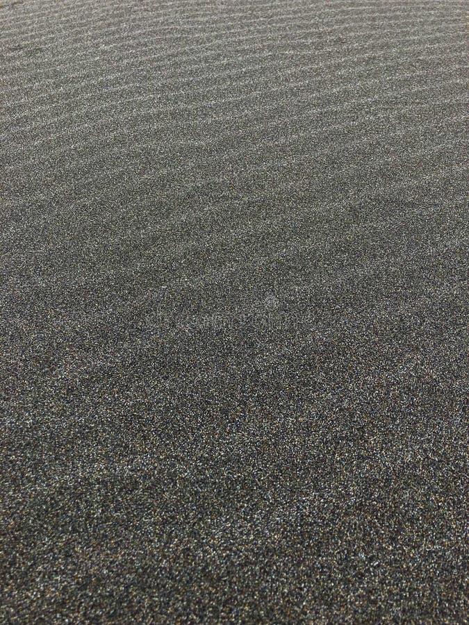 wind marks on the dark sand stock photos