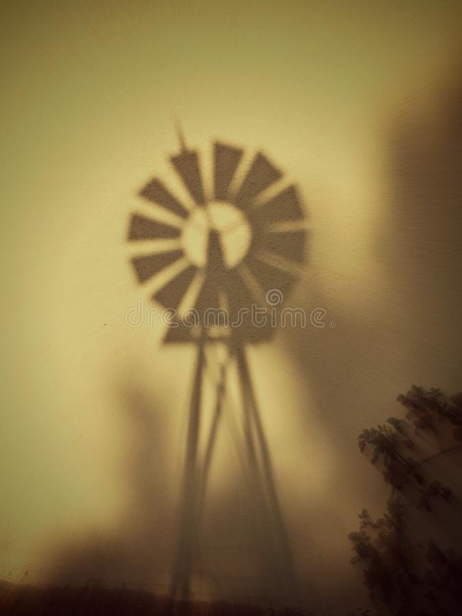 Wind mill on a wall royalty free stock photography