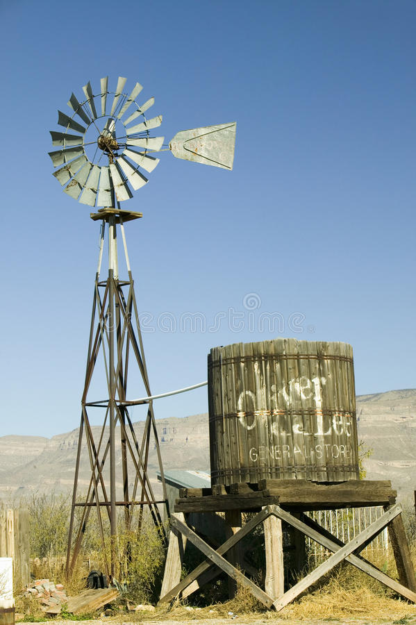 Wind mill and water tank royalty free stock photo