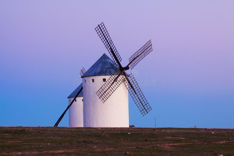 Wind mills at Campo de Criptana in evening. La Mancha royalty free stock image