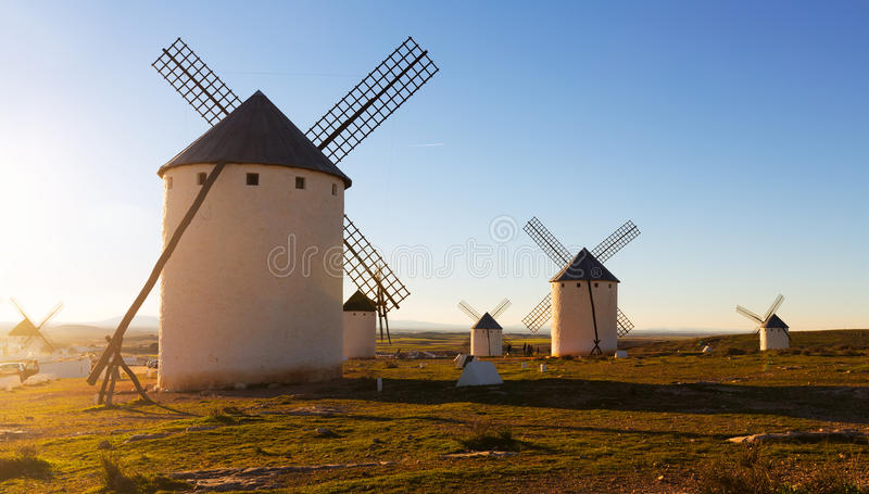 Wind mills at Campo de Criptana in evening sun stock photography