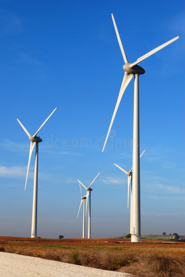 Wind Mills in front of the sun royalty free stock photo